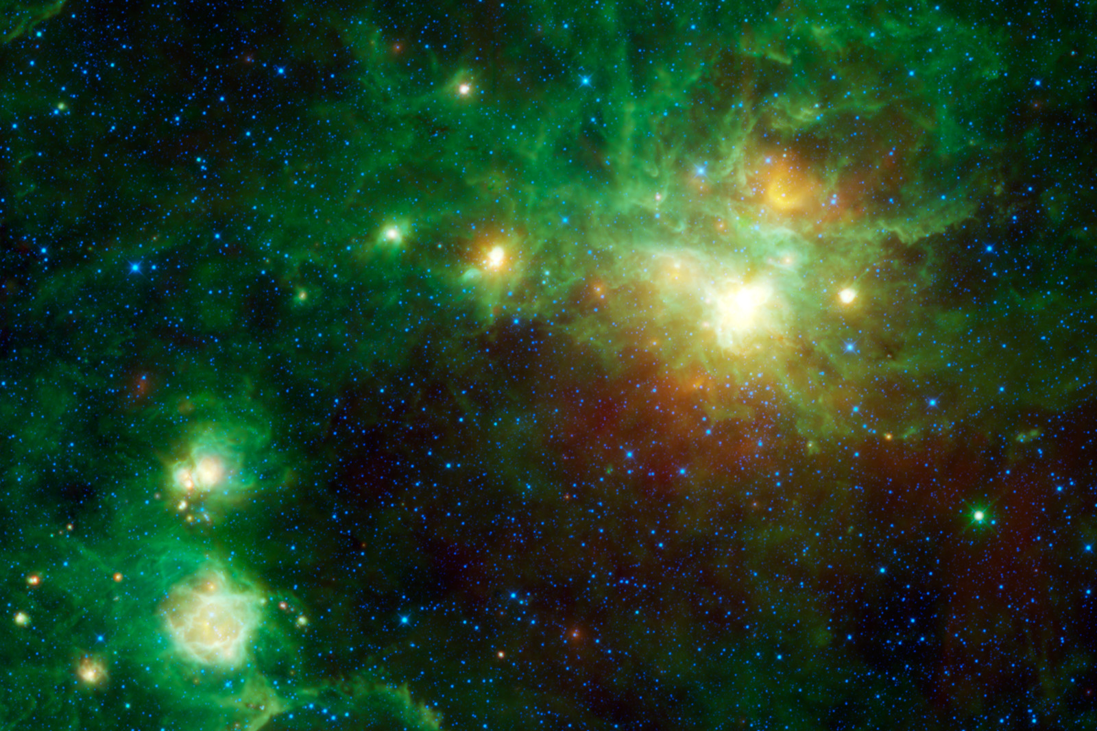 This image from NASAs Wide-field Infrared Survey Explorer, or WISE, highlights several star-forming regions. There are five distinct centers of star birth in this one image alone. Star-forming nebulae (called HII regions by astronomers) are clouds of gas and dust that have been heated up by nearby stars recently formed from the same cloud, and have appeared in previously featured WISE images.  The largest, brightest cloud, in the upper right is known as Gum 22. Its named after Colin Gum, an Australian astronomer who surveyed the southern hemisphere sky in the early 1950s looking for star-forming regions like these. He catalogued 85 new such regions, named Gum 1 to 85 (Gum Crater on the moon was also named in his honor).  Going counter-clockwise from Gum 22, the other catalogued nebulae in the image are Gum 23 (part of same cloud as 22), IRAS 09002-4732 (orange cloud near center), Bran 226 (upper cloud of the two at lower left), and finally Gum 25 at far lower left. There are also several smaller and/or more distant regions scattered throughout the image that have yet to be catalogued. Most of the regions are thought to be part of our local Orion spiral arm spur in the Milky Way Galaxy. Their distances range from about 4,000 to 10,000 light-years away.  Notice the very bright green star near the lower right portion of the image. You can tell its a star because it appears to have spikes sticking out of it (diffraction spikes like these are an optical effect caused by the structure of the telescope). Bright stars in WISE images are typically blue, so you know this one is special. Known as IRAS 08535-4724, its a unique type of stellar giant called a carbon star. Carbon stars are similar to red giants stars, which are much larger than the Sun, glow brightly in longer wavelengths, and are in the late stages of their lives. But they have unusually high amounts of carbon in their outer atmospheres. Astronomers think this carbon comes either from convection currents deep wit