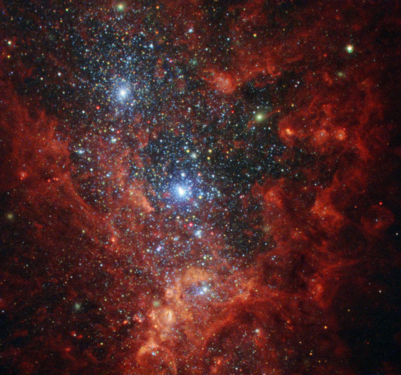 This NASA/ESA Hubble Space Telescope image reveals the iridescent interior of one of the most active galaxies in our local neighbourhood — NGC 1569, a small galaxy located about eleven million light-years away in the constellation of Camelopardalis (The Giraffe). This galaxy is currently a hotbed of vigorous star formation. NGC 1569 is a starburst galaxy, meaning that — as the name suggests — it is bursting at the seams with stars, and is currently producing them at a rate far higher than that observed in most other galaxies. For almost 100 million years, NGC 1569 has pumped out stars over 100 times faster than the Milky Way! As a result, this glittering galaxy is home to super star clusters, three of which are visible in this image — one of the two bright clusters is actually the superposition of two massive clusters. Each containing more than a million stars, these brilliant blue clusters reside within a large cavity of gas carved out by multiple supernovae, the energetic remnants of massive stars. In 2008, Hubble observed the galaxy's cluttered core and sparsely populated outer fringes. By pinpointing individual red giant stars, Hubble's Advanced Camera for Surveys enabled astronomers to calculate a new — and much more precise — estimate for NGC 1569's distance. This revealed that the galaxy is actually one and a half times further away than previously thought, and a member of the IC 342 galaxy group. Astronomers suspect that the IC 342 cosmic congregation is responsible for the star-forming frenzy observed in NGC 1569. Gravitational interactions between this galactic group are believed to be compressing the gas within NGC 1569. As it is compressed, the gas collapses, heats up and forms new stars.