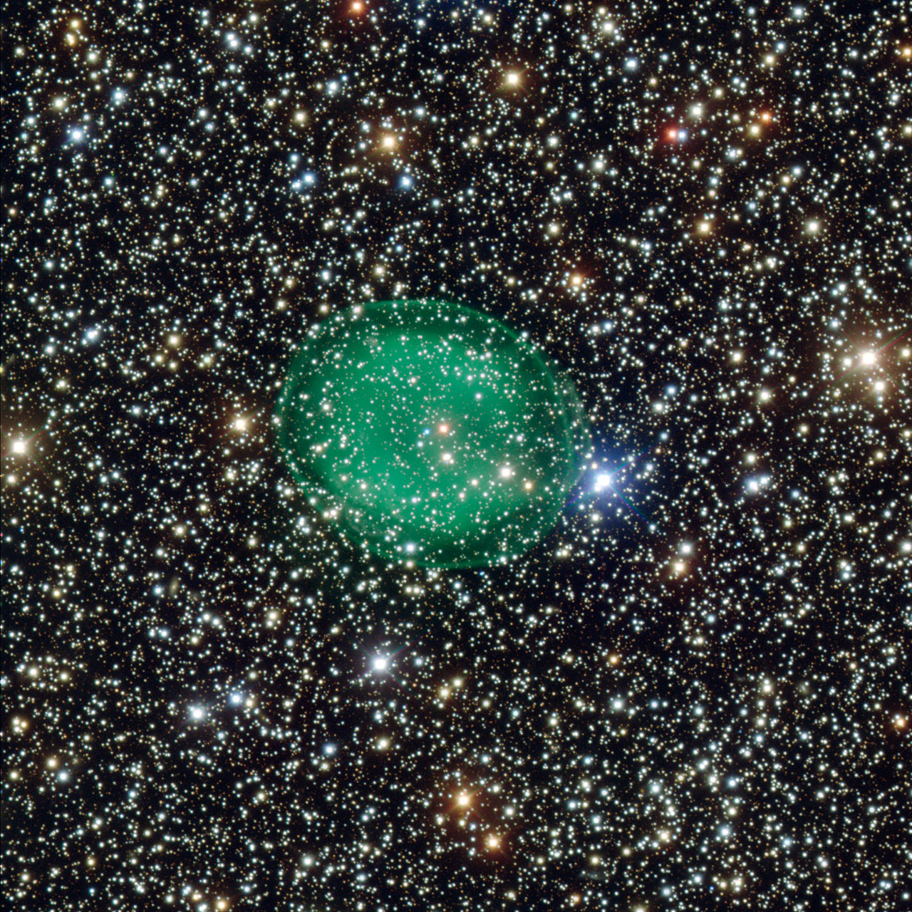 This intriguing picture from ESO's Very Large Telescope shows the glowing green planetary nebula IC 1295 surrounding a dim and dying star. It is located about 3300 light-years away in the constellation of Scutum (The Shield). This is the most detailed picture of this object ever taken.