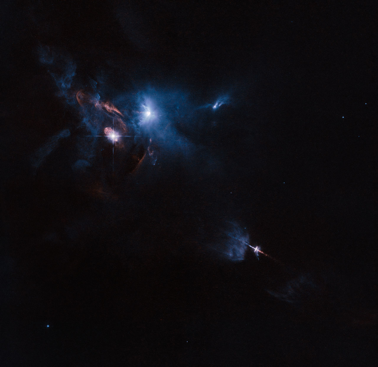 The NASA/ESA Hubble Space Telescope has snapped a striking view of a multiple star system called XZ Tauri, its neighbour HL Tauri and several nearby young stellar objects. XZ Tauri is blowing a hot bubble of gas into the surrounding space, which is filled with bright and beautiful clumps that are emitting strong winds and jets. These objects illuminate the region, creating a truly dramatic scene.