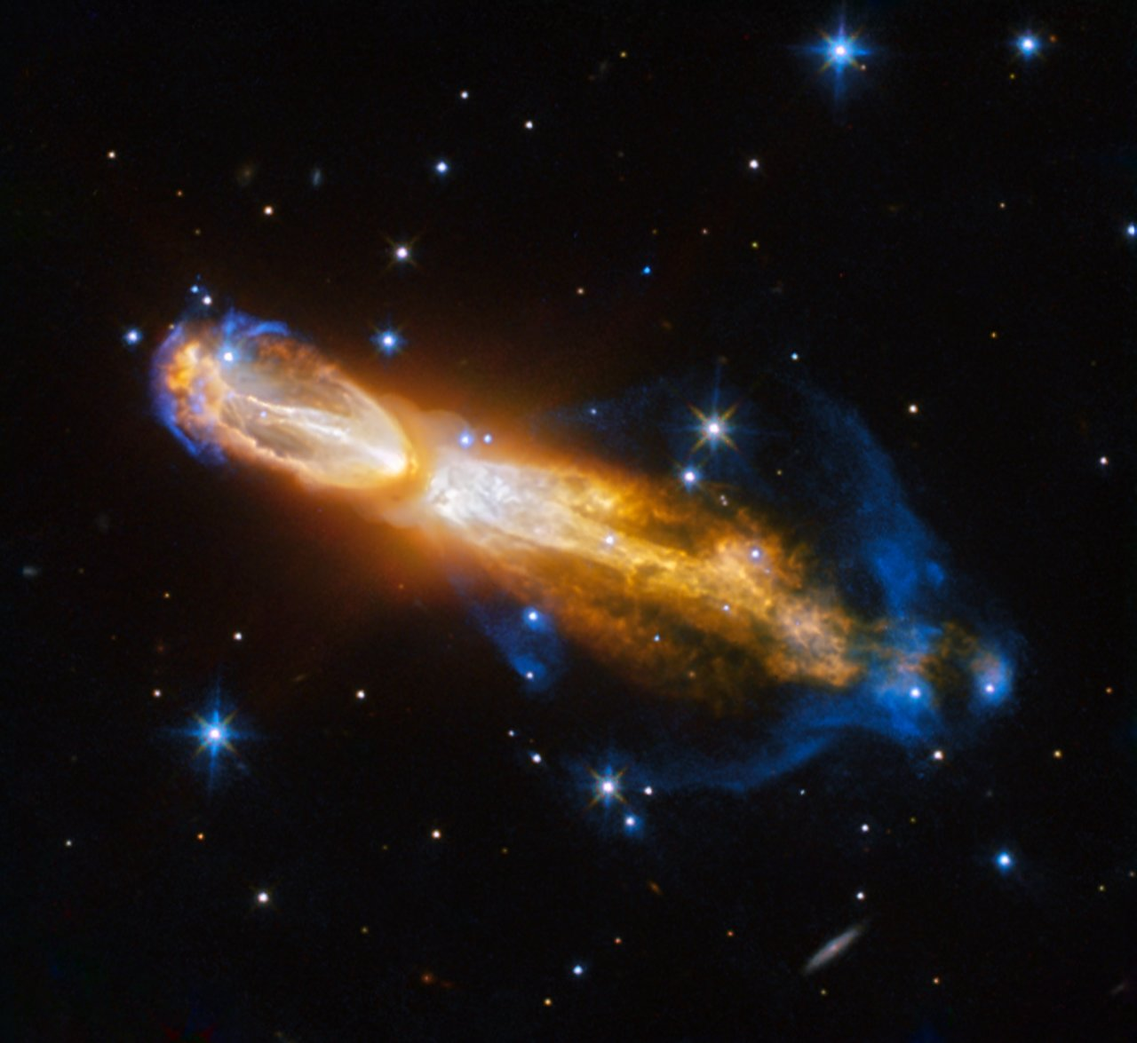 The Calabash Nebula, pictured here — which has the technical name OH 231.8+04.2 — is a spectacular example of the death of a low-mass star like the Sun. This image taken by the NASA/ESA Hubble Space Telescope shows the star going through a rapid transformation from a red giant to a planetary nebula, during which it blows its outer layers of gas and dust out into the surrounding space. The recently ejected material is spat out in opposite directions with immense speed — the gas shown in yellow is moving close to a million kilometres an hour. Astronomers rarely capture a star in this phase of its evolution because it occurs within the blink of an eye — in astronomical terms. Over the next thousand years the nebula is expected to evolve into a fully fledged planetary nebula. The nebula is also known as the Rotten Egg Nebula because it contains a lot of sulphur, an element that, when combined with other elements, smells like a rotten egg — but luckily, it resides over 5000 light-years away in the constellation of Puppis (The Poop deck).