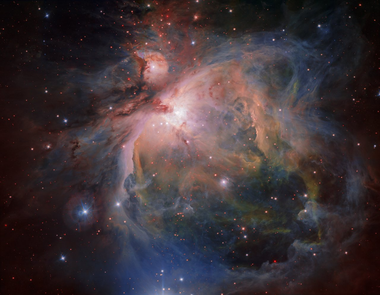 OmegaCAM — the wide-field optical camera on ESO's VLT Survey Telescope (VST) — has captured the spectacular Orion Nebula and its associated cluster of young stars in great detail, producing this beautiful new image. This famous object, the birthplace of many massive stars, is one of the closest stellar nurseries, at a distance of about 1350 light-years.